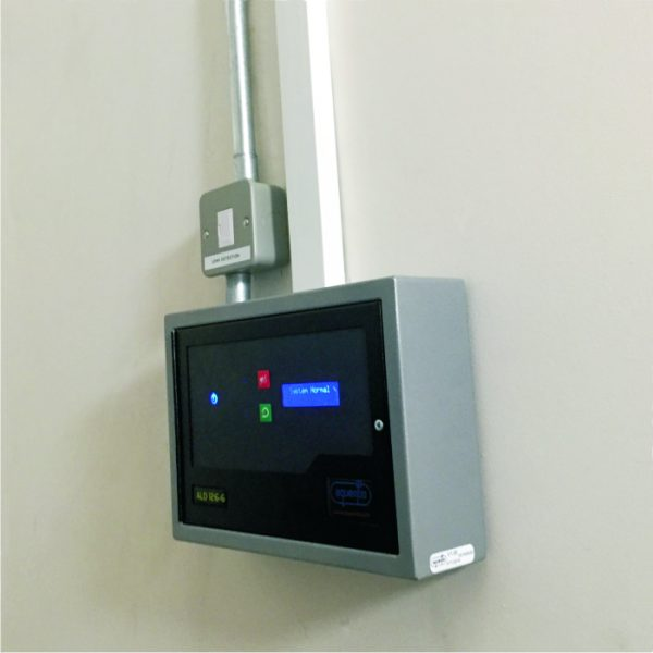 A Aquentis ALD126-6 6 Zone leak detection panel installed within a commercial space